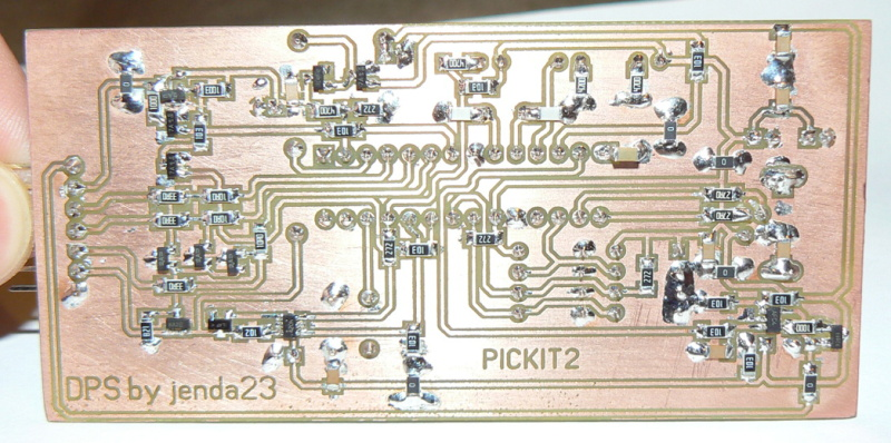 http://electronics-diy.com/pickit-2-clone.php.  See this in semi SMD variant with EEPROM which can contain firmware.